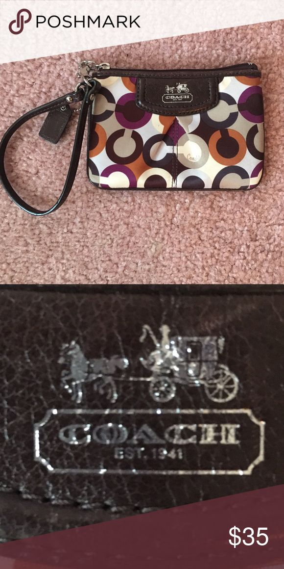 Coach wristlet This is a small coach wristlet I got a few years ago. I've used it a few times but there is no wear and tear on it. It's real, originally 80$ Coach Bags Clutches & Wristlets