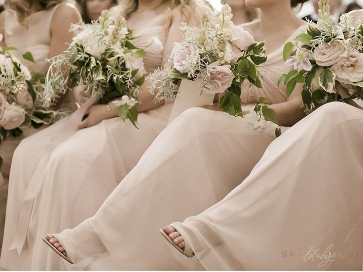 pale pink bridesmaids dresses with matching flowers #realwedding