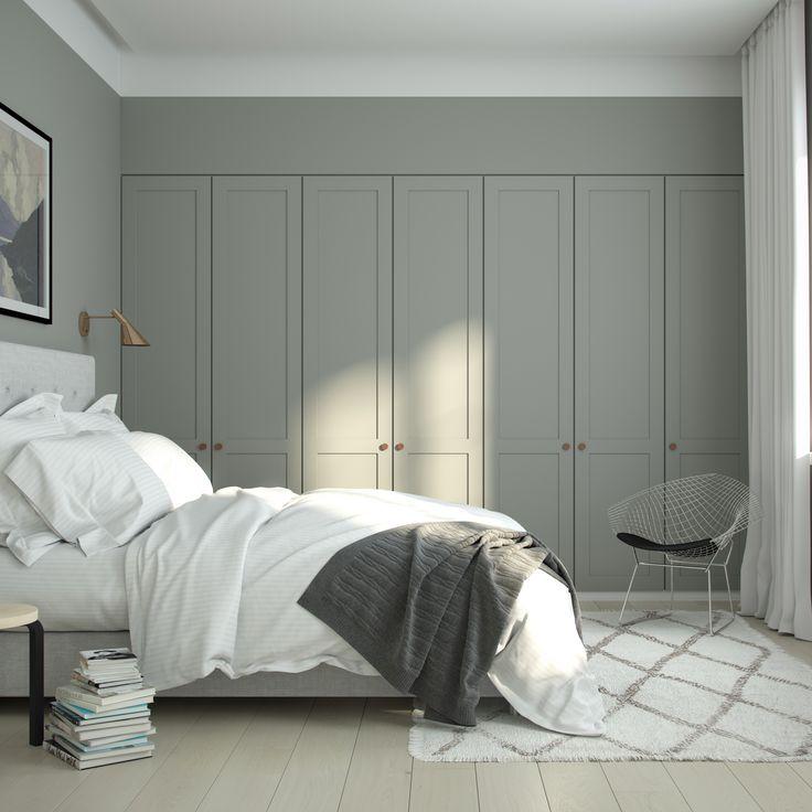 Cozy bedroom with A.S.Helsingö wardrobe. ENSIÖ wardrobe doors on IKEA PAX cabinet frames. PARASOL handles in copper.