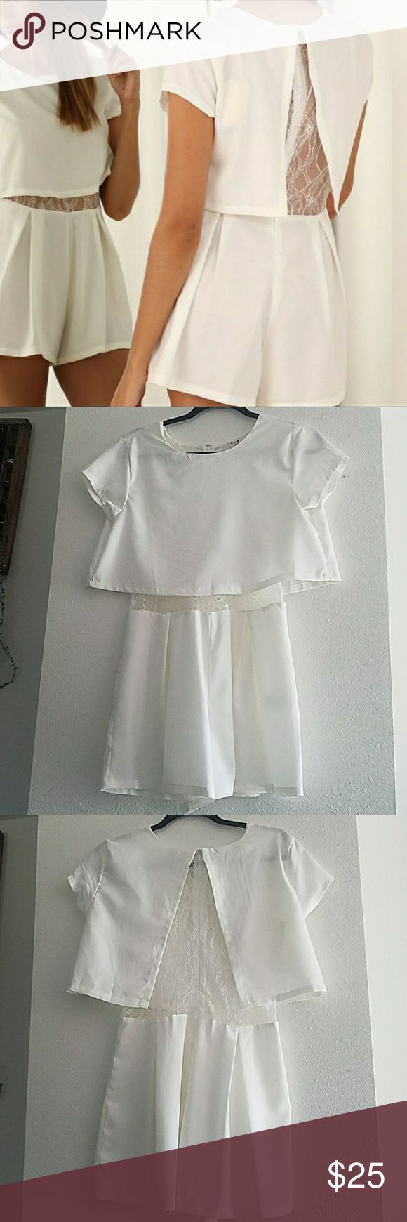 White romper NWOT Bought this at an Apricot Lane boutique, took the tags off but it's never been worn. uniq Shorts