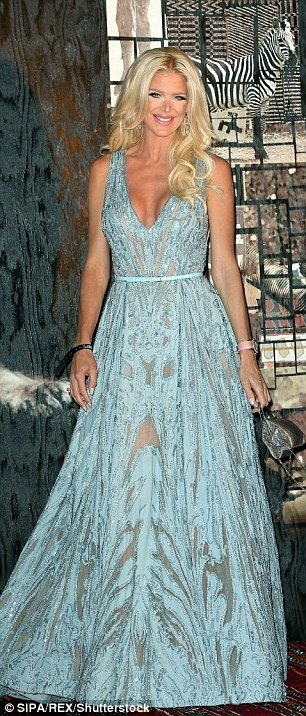 Racy lacy: Stunning Swede Victoria Silvstedt sported a green gown which made the most of h...