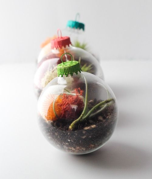 """I have a new """"gotta try this""""...I have tons of clear glass ornaments from my failed craft sale era.  How much fun could I have with this...different shades of rocks (also have gravel from failed goldfish attempts,) different hooks and ribbons to suspend them...oh, yes.  This I MUST try."""