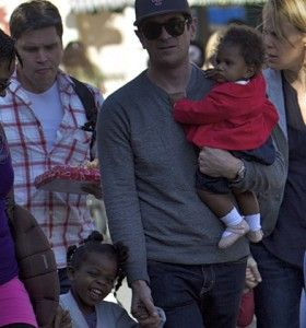 Ty Burrell of TV's Modern Family adopted two black girls, not at the same time.