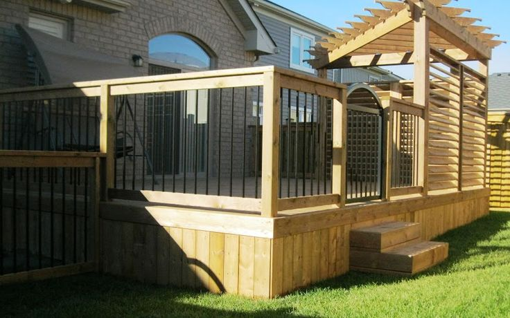 The Deck Guys. solid skirting, black balusters, slatted screen