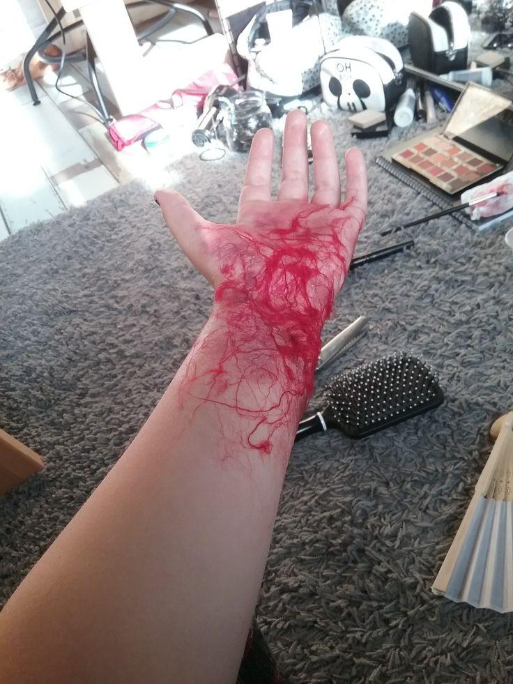 Red wool shredded, pva water based glue, red eyeshadow