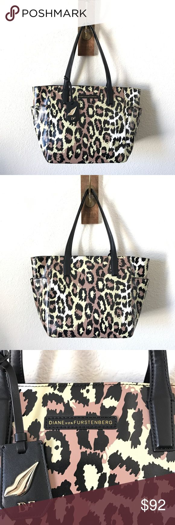 Diane von Furstenberg Coated Canvas LEOPARD Tote😍 Beautiful DVF tote, with black flat leather shoulder straps & magnetic snap closure. Will come with authenticity cards, no dust bag. One zipper pocket & two interior open pockets. EUC.   SELLERS NOTE:  •All items are inspected and described as thoroughly and honestly as possible.  •Items are sold as is (as described)  •Each order is packaged with extreme CARE & SHIPPED SAME/NEXT BUSINESS DAY, unless seller communicates otherwise. Diane von…
