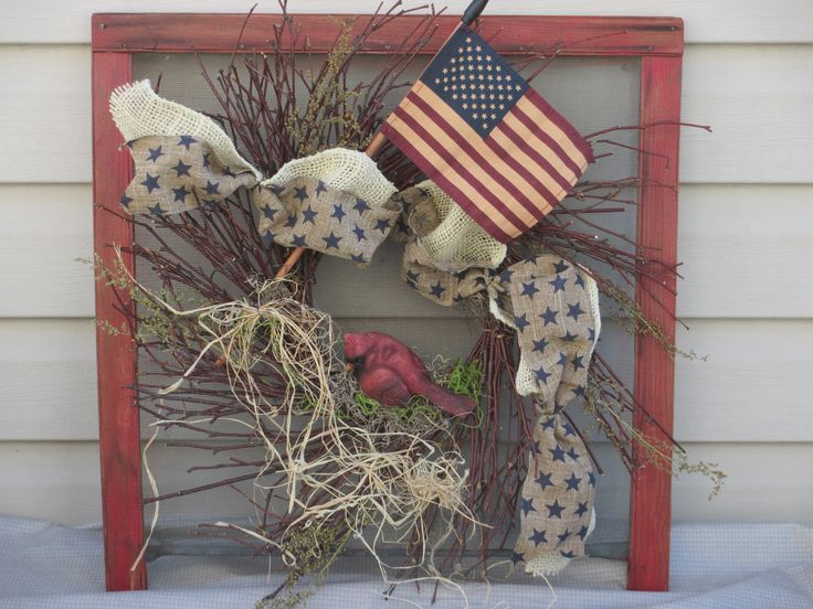 A section of an adjustable window screen now displays a patriotic wreath with flag by Joan Larson
