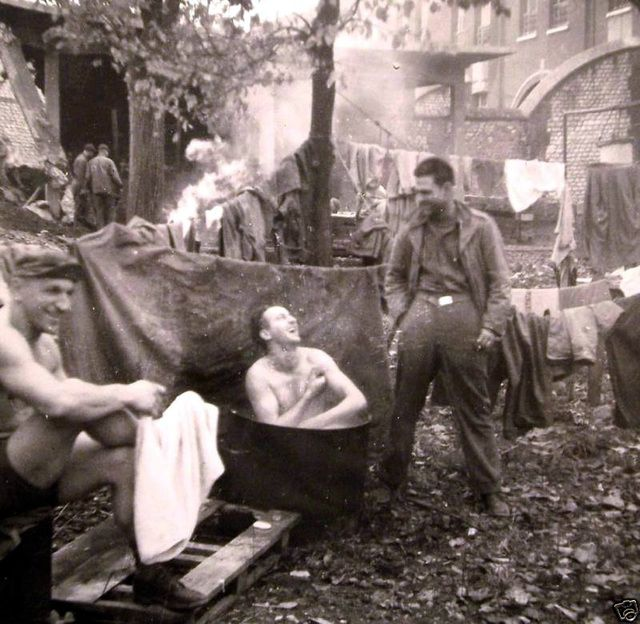 Wash day for this group of GIs, somewhere in Europe - World War II