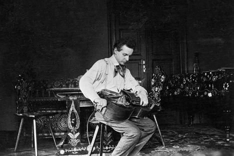 "Bela Bartok, playing a Hungarian folk instrument, ""tekero""--  Google Image Result for http://pctrs.network.hu/clubpicture/1/5/8/4/_/bartok_bela_tekeron_jatszik_budapesti_otthonaban_1908_mta_zenetudomanyi_intezet_bartok_archivum_fototarabol_1584219_1220_n.jpg"