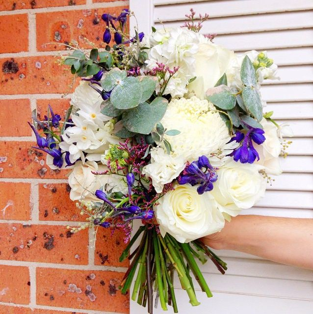 A Blooming Brilliant Wedding - Bridesmaid Bouquet, Boutonniere, Corsage, for Stef and David. Including a classic look for recycled glass jars with hand-tied bows, jute string, and tulips, pom pom chrysanthemum, roses, eucalyptus, lisianthus, iris, Australian Natives, jonquil, stattice, and misty.