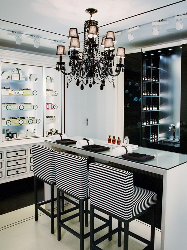 Take a seat at the Tasting Bar™ | Jo Malone boutique shop | clean, simple and beautiful with unexpected chandelier