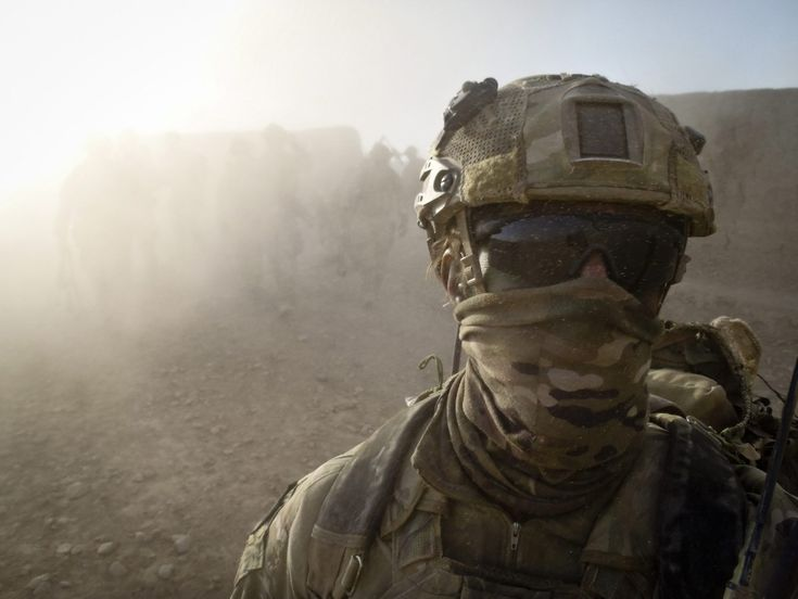 An Australian special forces soldier walks ahead of his Afghan National Security Force and Australian Special Operations Task Group comrades after a mission in Helmand province, southern Afghanistan.