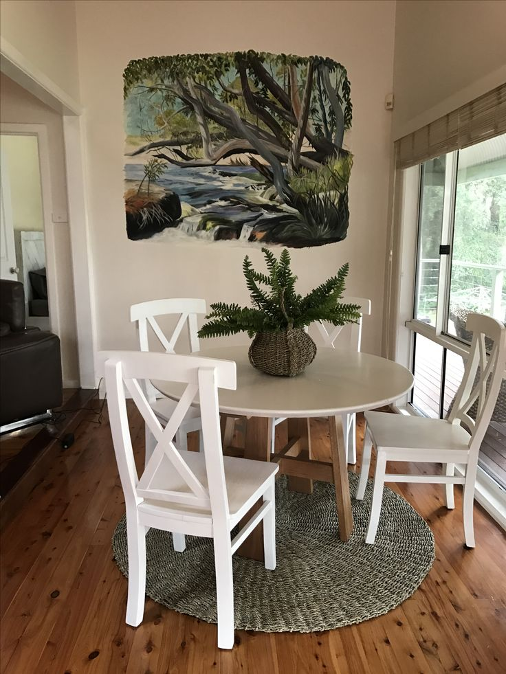 "Round Mountain Ash ""Ottway"" design dining table with ""Hamptons"" white chairs."