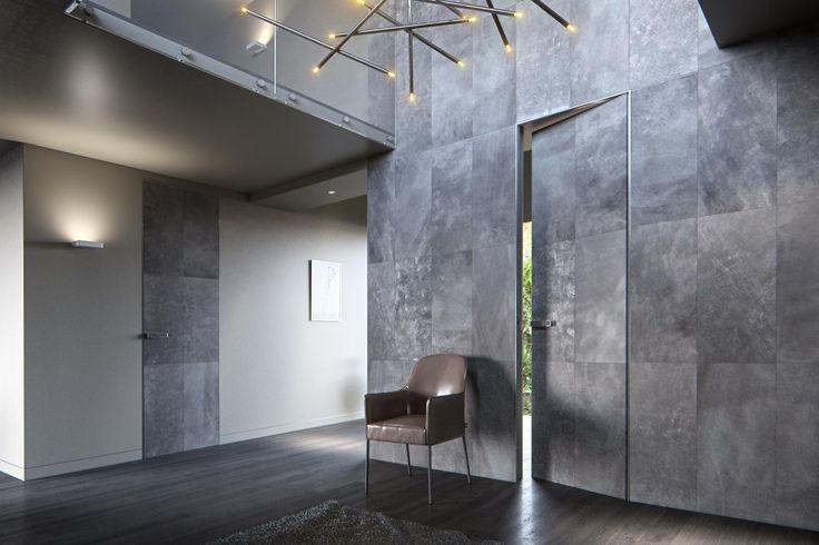 PIU Design: wysokie drzwi wykończone naturalną skórą z oferty marki Alphenberg, wykonane w technologii Aluminium Design