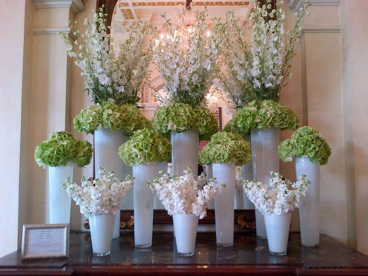 Green and white hotel lobby display. White delphinium, green hydrangea and white stock.