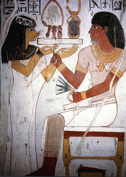 Detail of a painting in the Tomb of Sennefer, Mayor of the Southern City, TT 96 in the Tombs of the Nobles in Thebes. Meryt was the 'beloved one' to her husband Sennefer, therefore, she appeared with him in most of the scenes in the tomb. She is offering him here a necklace with a scarab. She also presents him with the three signs of Ankh, the symbol of life, and Djed, the symbol of stability, power and dominion.