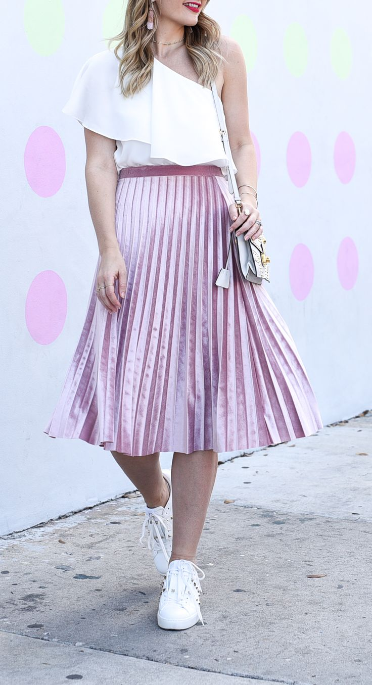 Pleated velvet pink skirt with a one shoulder white tank top and sneakers | fashion inspiration | style outfit ideas for spring