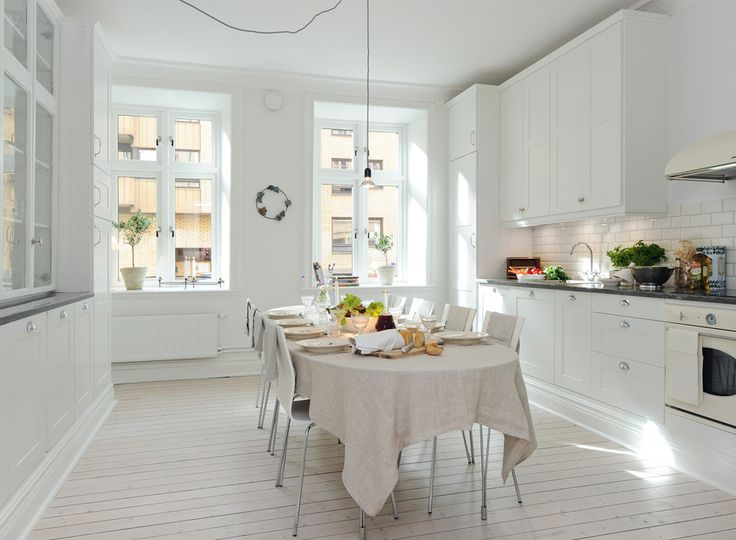 so clean, so fresh.  love the all white.  cute how most of the color comes from the veggies and plants.