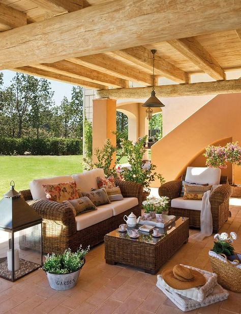 30 Serene Outdoor Living Spaces - Style Estate . Muebles de mimbre o ratán para el porche mediterráneo.**