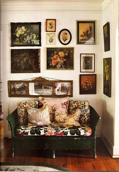 This image offers great tips on decorating with florals- a group of botanical themed prints and paintings cover the wall and the theme is carried through to the cushions and deep leafy green cane sofa. This would work in a hallway, bedroom, walk-through room or even a bathroom!