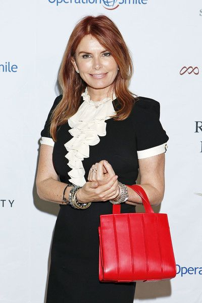 Roma Downey Leather Tote - Roma Downey brightened up her monochrome dress with a red leather tote when she attended Operation Smile's Celebrity Ski