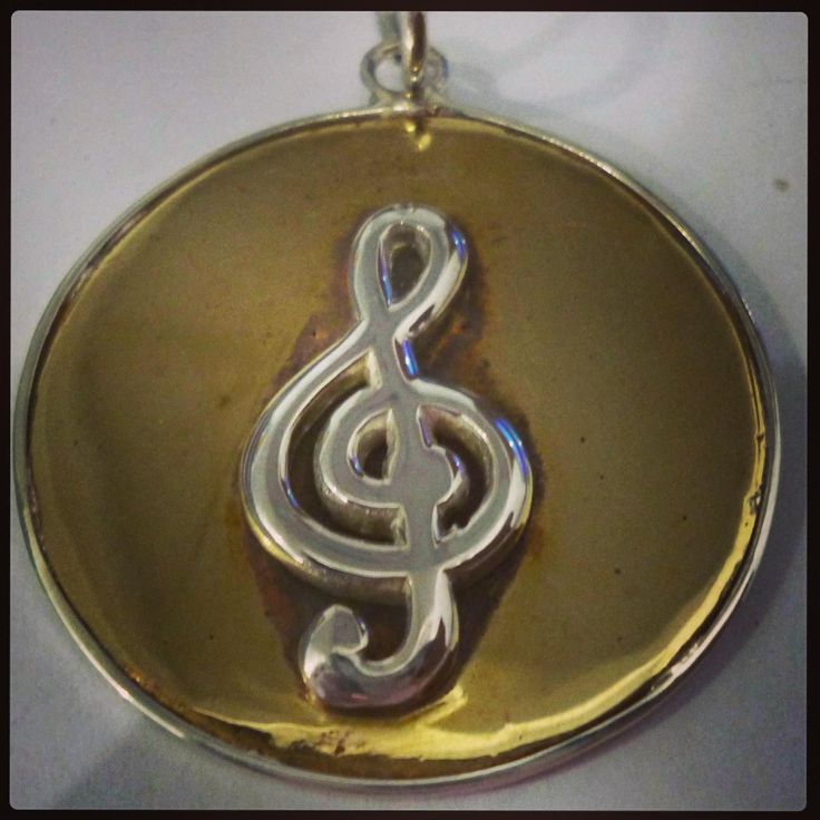 For the music inspired, Sterling silver and Brass handmade Charm.