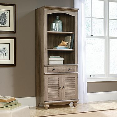 Library With Doors - Harbor View A staple for anyone's executive office. Or added beauty to a living room, dining room, anywhere. The salt oak finish brings a soft look to your home.