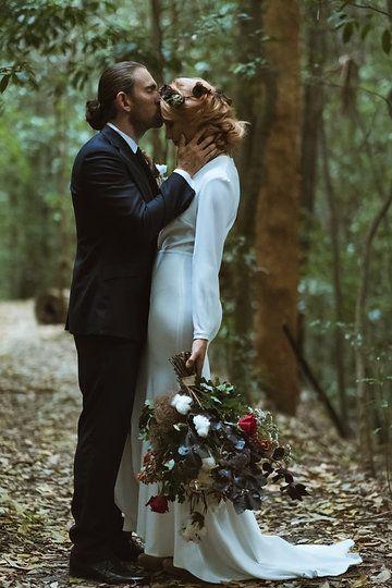 bouquet of cotton long sleeve wedding dress retro wedding dress front split wedding dress Mina Mancini Couture dress