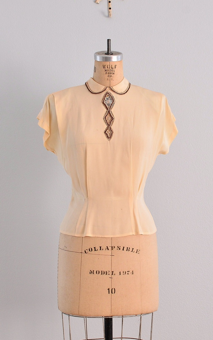 1940's cream rayon blouse with shoulder tucks and waist tucks/released darts.  Beaded and faggotted/openwork neckline and collar details.