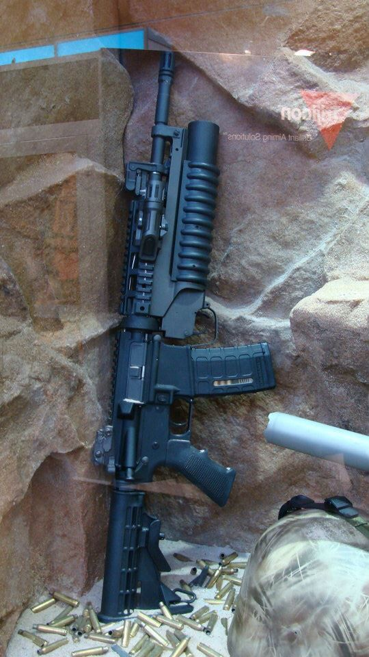 AR-15 (5.56) with attached M203 40mm grenade launcher