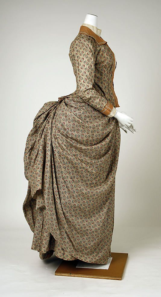 Victorian haute couture fashion walking dress gown from French 1885. Made from cotton print, embroidery trim and copper embellishment. A modern representation of women clothing throughout the #historical #19th century. Although the silhouette remained the same incorporated menswear affectations into both ornamentation and construction with high neck, long sleeves with collar,cuff and decorate decollete. The skirt drape with bustle at the back. #hautecouture #couture #vintage #victorian…