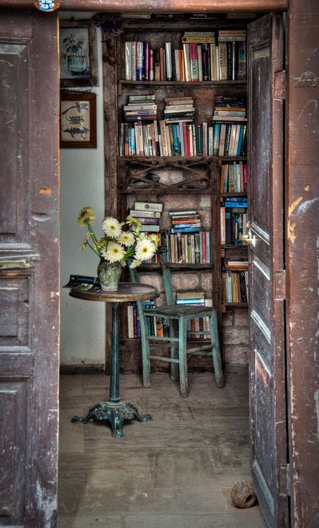 The shabby bookcases filled with books, of course. But check out the little table with the turtle base, swoon!