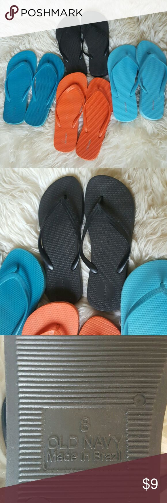 """Old Navy Flip Flop Bundle 4 sets of Old Navy flip flops. Orange, light blue and shimmery black are brand new - Darker blue has been worn a couple of times but in good condition - Orange, light blue and dark blue Size """"7-8"""" - Black size 8 - The black sandals are a bit thicker and made out of rubber - Other sandals made out of foam Old Navy Shoes Sandals"""