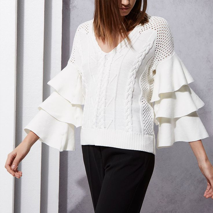 beautiful white sweater ,is it ?