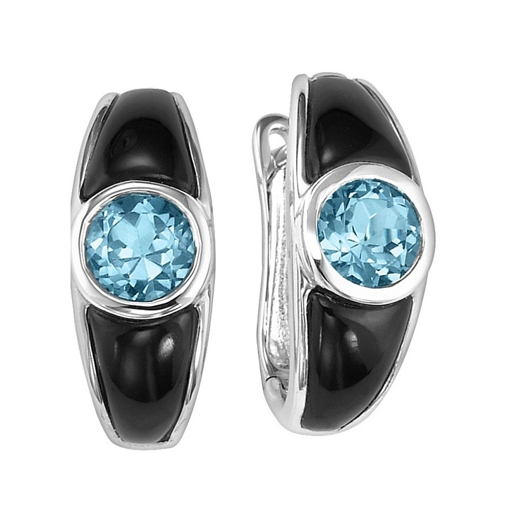 Diamond Jewellers :: Sparkling Blue Topaz with dramatic black onyx inlay set in sterling silver earrings. Wow the December-born birthday girl with a dazzling pair that's just her style! Fashioned in sleek sterling silver, the blue topaz center stone that draws the eye. The bo