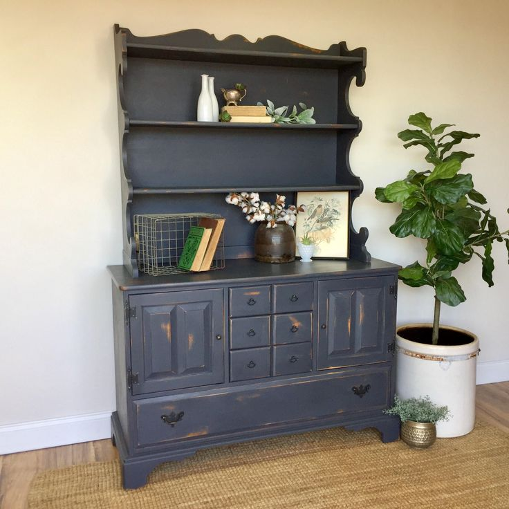 """This solid Maple wood hutch will add much interest to your space. The rustic, distressed patina fits perfectly into the farmhouse or country style interior. Adorn your kitchen or dining room with this piece that will add lots of storage space for dinner plates and dishes.  • Farmhouse Style • Strong and Sturdy • Solid Maple Wood  50"""" ..."""