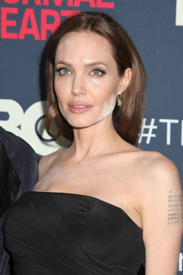 Hey, it's not entirely her fault, people.   Angelina Jolie Suffers A Serious Makeup Blunder On The Red Carpet