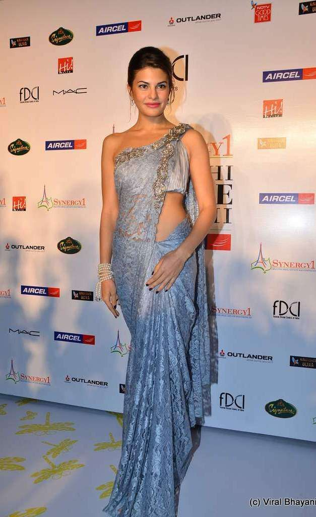 Jaqueline Fernandez in a blue saree or sari and blouse. #Hairstyle