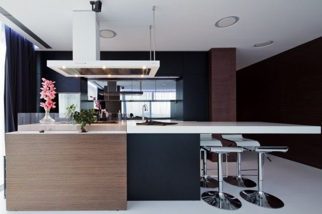 modern black brown kitchen island with white countertop bar stools and round white ceiling lights. Love this brown color for kitchen cabinets..