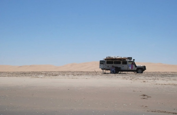 Karsten Vincent and his two boys in their '07 Defender Td5 130 CSW travelling along the Namib coast.