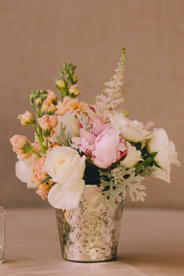 Love this sophisticated flower arrangement with this mercury glass vase! DIY your own mercury glass decor with our easy tutorial | http://www.weddingpartyapp.com/blog/2014/10/20/diy-mercury-glass-centerpiece-vases/
