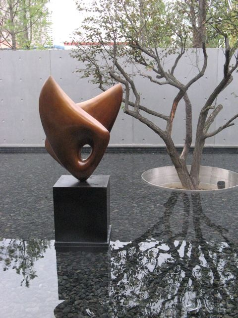 Shallow pool • sculpture • tree in water