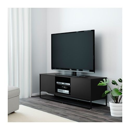 HAGGE TV unit IKEA The sliding door saves space and hides all your gadgets, while you still have them nearby when you need them.