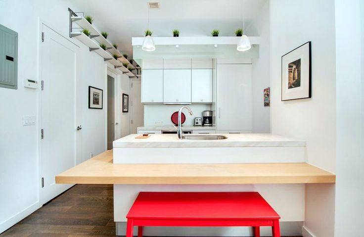 Small white contemporary kitchen with marble peninsula and red bench seating