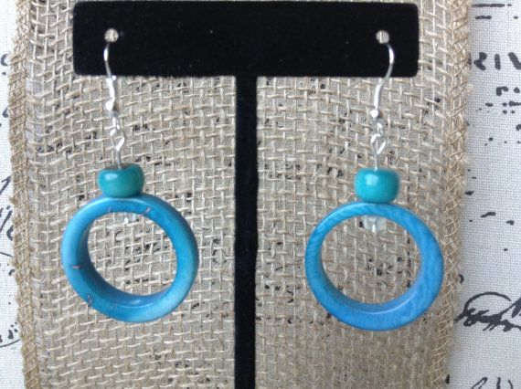 Turquoise blue dangle earrings made of tagua nut. Cool and modern jewelry