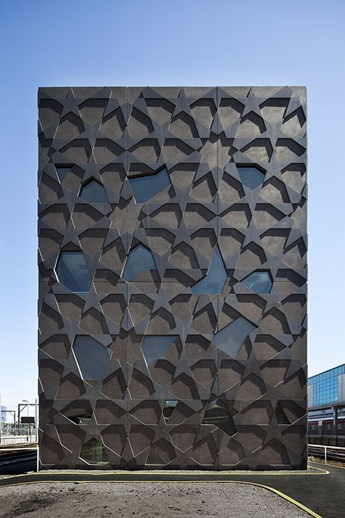 The Yardmasters Building in Melbourne, Australia By McBride Charles Ryan. Inspired by Melbourne's victorian-era public cast iron urinals.  Contemporary design with links to the past
