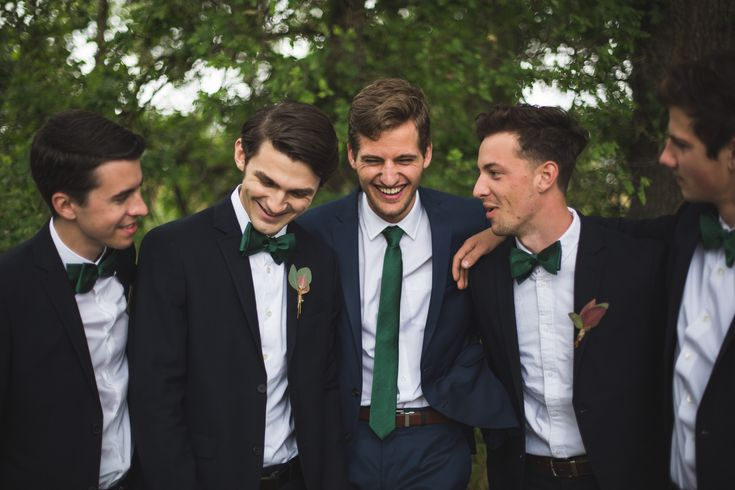 Cannot go wrong with a green tie for the groom and bow ties for the groomsmen!
