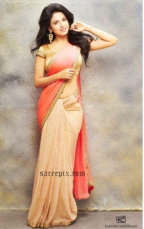 "Malayalam heroine Iswarya Menon(Aishwarya Menon)in saree and half saree from her recent photoshoot. The ""Monsoon Mangoes"" heroine looks gorgeous in printe"