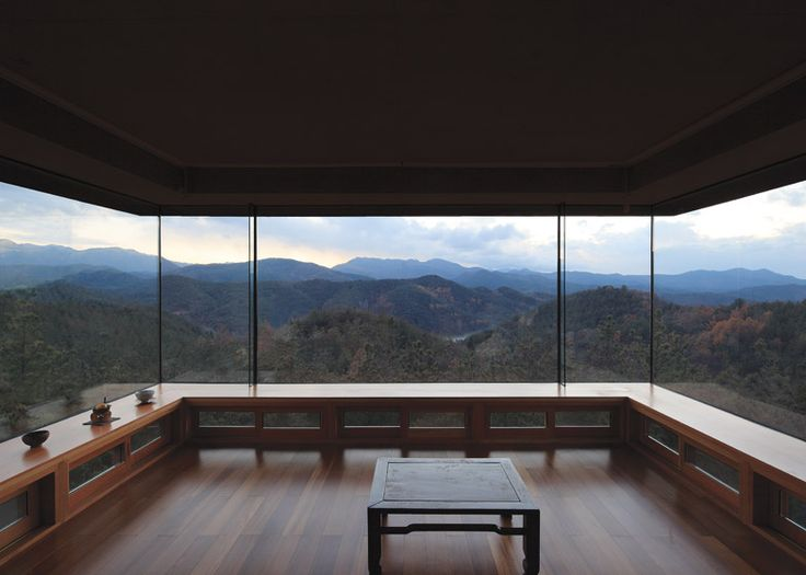 Korean architect Seung H-Sang, director of Seoul-based studio Iroje Architects & Planners, designed the secluded house for a plot among a fir forest and botanical gardens in Gunwi, a county in South Korea's Gyeongbuk province.