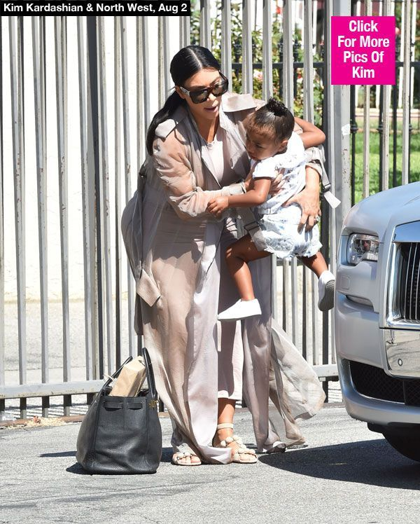 Kim Kardashian Struggles To Hold North West As Baby Bump Explodes — Pic